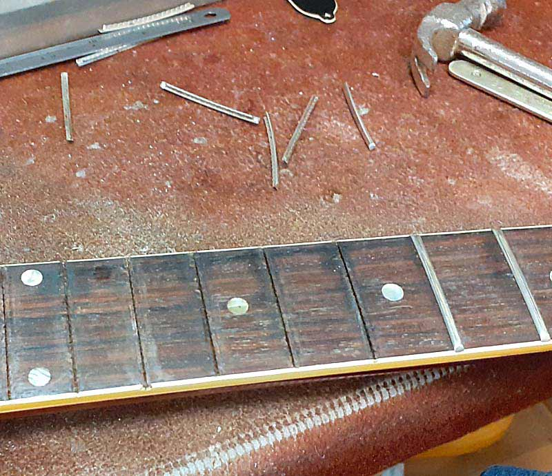 Replacing frets in the workshop.