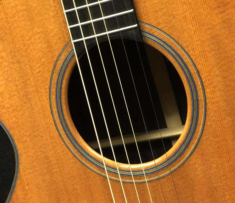 Close up of sound hole with rosette.