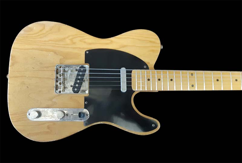 Natural wood body with black pick guard.